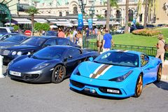 Ferrari 458 Speciale and McLaren MP4-12C. MONTE CARLO, MONACO - AUGUST 2, 2014: Supercars Ferrari 458 Speciale and McLaren MP4-12C at the city street near the Royalty Free Stock Image