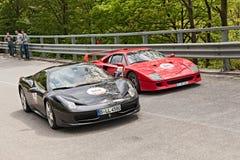 Ferrari spindel F40 och 458 i den Mille migliaen 2013 Royaltyfri Bild