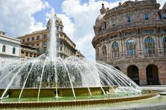 Piazza De Ferrari ,Genoa , Italy. Ferrari square in Genoa, the heart of the city with the central fountain and the Liberty architecture of the surrounding Royalty Free Stock Image