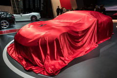 Ferrari 812 Superfast sports car veiled. GENEVA, SWITZERLAND - MARCH 7, 2017: New Ferrari 812 Superfast sports car veiled before presentation at the 87th Geneva Stock Photography
