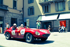 Ferrari 250 TR at Mille Miglia 2016. A Ferrari 250 TR passing through Tasso street Bergamo, Italy before the crowd during the 2016 Mille Miglia classic car race Royalty Free Stock Photo