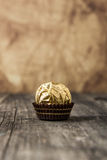 Ferrero Rocher Chocolate Hazelnut Candy in Gold Foil Stock Image