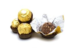 Free Ferrero Rocher Is Premium Chocolate Ball Sweets Filling With Nuts And Luxury Delicious. Italian Chocolate Candies Isolated On Whit Royalty Free Stock Photo - 174639565