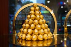 Ferrero Rocher pyramid. A Ferrero Rocher pyramid constructed by 100 Ferrero chocolate Royalty Free Stock Photo