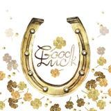 Ferri di cavallo dorati dell'acquerello con il trifoglio Fotografia Stock