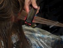 Ferri piani infrarossi dei capelli nocivi restauro fotografie stock libere da diritti