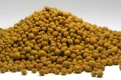 Ferric chloride balls in light back Stock Image