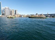 Ferries approaching the Quay. Sydney Ferries approaching the Quay with the city behind Royalty Free Stock Images