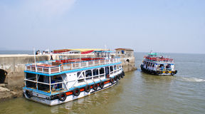 Ferries and boats anchored at Elephanta Island. Waterways, even though it takes longer time, is a preferred mode of transportation for the tourists, to travel to Royalty Free Stock Images