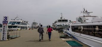 Ferries docking at tourist jetty royalty free stock photography