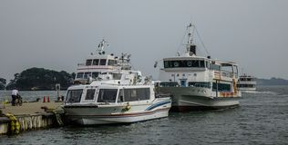 Ferries docking at tourist jetty royalty free stock photos