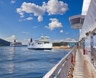 Ferries, fjord of Norway in a sunny day Royalty Free Stock Photography