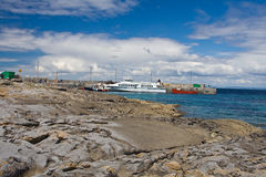 Ferries at Inisheer. Ferries docked at Inisheer harbour in Ireland stock image