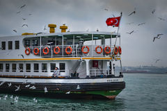 Ferries in Istanbul. Commuter ferries have been operating on th. Istanbul, Turkey - December 21, 2012:  Ferries in Istanbul Stock Image