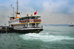 Ferries in Istanbul. Commuter ferries have been operating on th. Istanbul, Turkey - December 21, 2012:  Ferries in Istanbul Royalty Free Stock Photos