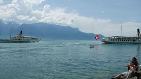 Ferries passing each other on Lake Geneva stock footage