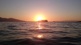Ferries at sea in Izmir gulf at sunset stock video footage