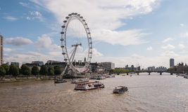 Ferries on the Thames River near the London Eye Royalty Free Stock Photos