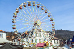People enjoy the 24th Barbarossamarkt festival. GELNHAUSEN, GERMANY - MARCH 9. people enjoy the 24th Barbarossamarkt festival with a ferries wheel on March 9 stock photos