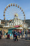 People enjoy the 24th Barbarossamarkt festival. GELNHAUSEN, GERMANY - MARCH 9. people enjoy the 24th Barbarossamarkt festival with a ferries wheel on March 9 royalty free stock images