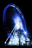Ferris катит внутри движение в nighttime Стоковая Фотография