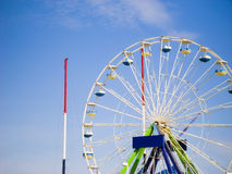 Ferris or big wheel. Scenic view of colorful ferris or big wheel with blue sky and cloudscape background Royalty Free Stock Photos