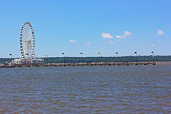 Ferris of National Harbor and a long pier in Maryland, USA. Royalty Free Stock Photo