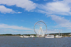 Ferris of National Harbor in Oxon Hill, Maryland, USA. Boats and yachts at National Harbor pier on a bright sunny day Royalty Free Stock Photography