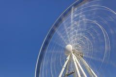 Ferris rueda adentro el movimiento Fotos de archivo libres de regalías