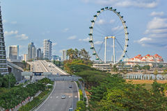 Ferris weel and highroad in moderm cityscape, Singapore stock photos
