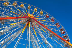 Ferris_wheel_01. A colorful ferris wheel against a deep blue sky in a summer day stock photo
