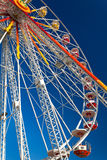 Ferris_wheel_01. A colorful ferris wheel against a deep blue sky in a summer day stock photography