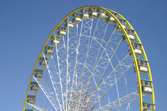 Ferris wheel. Top half of ferris or observation wheel with blue sky background royalty free stock photography