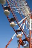 Ferris wheel. Portion of a ferris wheel. Blue sky in background Royalty Free Stock Image