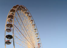 Ferris wheel. Modern ferris wheel against clear blue sky Stock Images