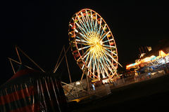 Ferris wheel. Shot of a ferris wheel and midway lit up at night during the Erie County Fair in New York Royalty Free Stock Photo