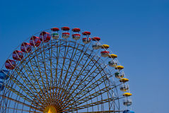 Ferris Wheel. On a cloudy sky background Stock Image