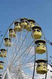 Ferris wheel. Yellow capsules on a ferris wheel, a traditional fair and festival ride Stock Photo