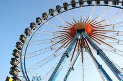 Ferris Wheel. Against bright blue sky on amusement park Royalty Free Stock Photos