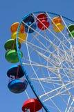 Ferris Wheel. A colourful ferris wheel against a deep blue sky. Diagonal view Royalty Free Stock Photos