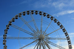 Ferris Wheel. A Ferris wheel (also known as an observation wheel or big wheel) is a nonbuilding structure consisting of a rotating upright wheel with passenger Stock Images