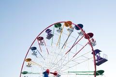Ferris wheel. Multicolor ferris wheel against a blue background Stock Photos
