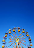 Ferris wheel. With numbers isolated on pure blue sky in background Royalty Free Stock Image