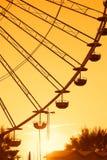 Ferris wheel. With amazing orange sky at sunset Stock Image