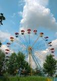 Ferris wheel. In amusement park against blue sky Royalty Free Stock Image