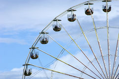 Ferris Wheel. A picture of part of a ferris wheel and its carriages high up in the air Stock Photos