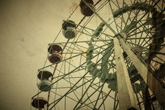 Ferris wheel. Aged vintage photo of carnival ferris wheel with toned f/x Royalty Free Stock Photography