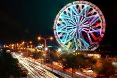 Ferris wheel and blurry night traffic lights. Picutre of a ferris wheel and blurry night traffic lights Stock Photos