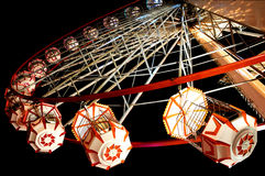 Ferris wheel. Low view of a fair round ferris wheel at night Stock Photo