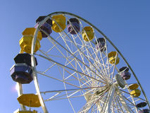 Ferris Wheel. An interesting perspective of a ferris wheel against a clear blue sky Royalty Free Stock Photo